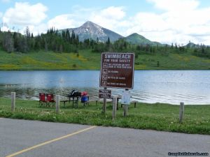 camp-out-colorado-steamboat-lake-swim-beach-sign